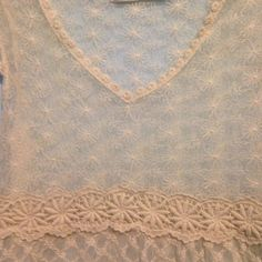 "Lace top Cream lace top from Solitaire with embroidered flowers along the waist, collar, waist and sleeve. Unlined. 100% polyester. 26""from shoulder to hem and 17"" across the bust. Very boho. Great for spring and summer! Solitaire Tops"