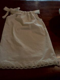 simple pillowcase dress, tea dyed cotton, hand sewn lace gives it a vintage pillow case feel.  I love having one big bow tied to the side