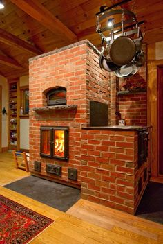 Masonry heater with pizza oven.