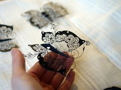 Super fine, lacy artwork masterfully cut from sheets of paper by artist Hina Aoyama