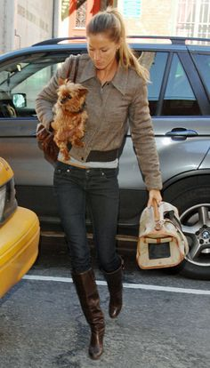 Brazilian supermodel Gisele Bündchen is seen here with her little Yorkie, Vida.