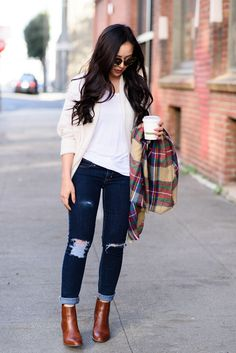 Keep it simple with an airy knit cardigan and plaid scarf this fall.
