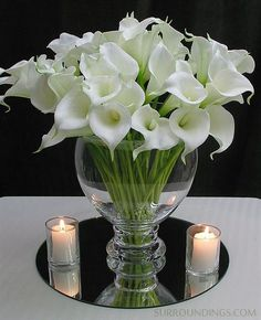 Amazingly realistic Calla lily flowers, look real and feel real. Display a single one or many in your favorite vase. Add water to give the illusion of fresh flowers. Calla flowers are tall and come in bundles of nine flowers. Calla Lillies Centerpieces, Floating Candle Centerpieces, Wedding Centerpieces, Wedding Table, Centerpiece Ideas, Fish Bowl Centerpieces, White Flower Centerpieces, Wedding Band, Wedding Decor