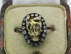 A Stunning Memento Mori Skull & Snake Ring Dated 1779. You have to see the band! Amazing memento ring.