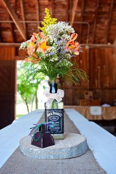 My Jack Daniels centerpieces :) Photo By Pixelated Photography (Whiskey Bottle Centerpieces) Wedding Vase Centerpieces, Bottle Centerpieces, Wedding Decorations, Friend Wedding, Our Wedding, Dream Wedding, Wedding Stuff, Jack Daniels Wedding, Alcohol Bottle Decorations