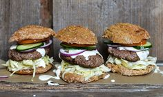 Juicy burger with creamy white cheese sauce and pickled cabbage