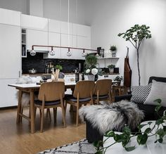 Livingroom with grey, pillows, plants and figtree. Slanted walls. See more pics at @KreaVilla