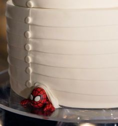 What a great idea! Hide his favorite super hero under the cake...this would be perfect if me and my ex boyfriend got married