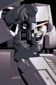 "Megatron (with Reflector) re-enacting ""The Killing Joke"" cover. #Transformers #Batman"