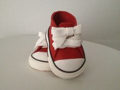 baby red sugar tennis shoes,  baby gum paste tennis shoes, baby fondant tennis shoes.