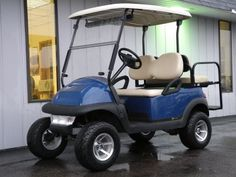 This sporty 2007 Club Car Precedent electric golf cart is well-equipped and ready to impress with brand new batteries and blue body.  Not only is it beautiful, but this custom golf cart also features a long list of features and accessories, including 3-inch lift kit, deluxe lights, rear flip seat, 20-inch tires on 12-inch alloy wheels, digital charge gauge, 5-panel rear view mirror, and more!