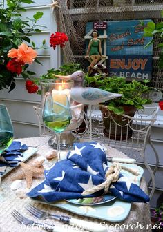 Beach Coastal Tablescape with Sailboats and Shell Plates and Star Napkins from Between Naps on the Porch.