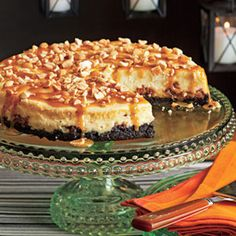Snickers cheese cake • 3 8-oz. packages cream cheese, at room temperature  • 3/4 cup sugar  • 3 large eggs, at room temperature  • 2 teaspoons vanilla extract  • 1 teaspoon lemon juice  • 1 tablespoon cornstarch  • 3 regular-size Snickers bars, cut into 1/4-inch slices  • 1/4 cup caramel sauce, optional  • 1/4 cup chopped roasted and salted peanuts,