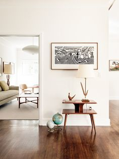 A vignette featuring vintage globes and Hollywood Limousine, a print by Stanley Donwood  purchased at Shepard Fairey's gallery.