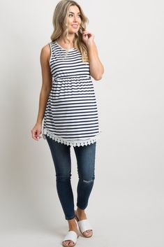 Navy Blue Striped Sleeveless Peplum Tunic A sleeveless peplum maternity tunic featuring a striped print, a rounded neckline, and a crochet trim on hemline. This style was created to be worn before, during, and after pregnancy. Maternity Swimsuit, Maternity Tunic, Maternity Dresses, Stitch Fix Maternity, Maternity Style, Maternity Clothes Spring, Summer Maternity Fashion, Pink Blush Maternity, Pregnancy Outfits