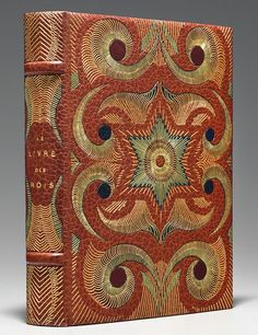 "Book Cover / 1930 Gonin edition of Le Livre des Rois. L'Avènement de Salomon, illustrated by French artist François-Louis Schmied / ""an Art Deco–bookbinding fantasia, wrought in morocco leather in shades of orange, blue, and red, and highlighted with intricate gilding"" -- Architectural Digest"