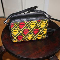 Stylish shoulder purse re-branded with Ankara fabric/African print black/multi red and yellow diamond