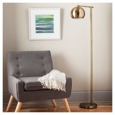 Smart-looking and decidedly modern, the Threshold Modern Globe Floor Lamp  - Brassy Gold looks right at home in your office or mixing in with your contemporary living room furniture. The brushed brass finish, weighted base and rounded cup shade all combine for a clean and beautiful lighting look you'll love reaching for when you need to brighten up the room.