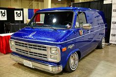 Check out this 1989 Chevy Van 10 we came across at the 2019 Grand National Roadster with a candy blue jumbo flake paint job, silver leafing, pinstriping, and a set of Truespoke Classics. Lowered Trucks, Gm Trucks, Chevy Trucks, Gmc Vans, Skateboard Deck Art, Astro Van, Old School Vans, Vanz, Custom Muscle Cars