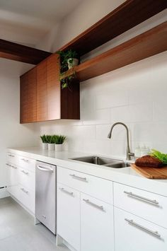 still loving the white on white- modern kitchen by Buchman Photo