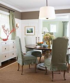 Pretty: paneled wall, grasscloth covered furniture, round table, pendant light