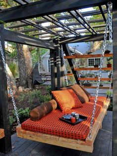 Asian Outdoor Daybed With Orange Color Cover As Comfortable Place At The Midle Of Garden Get more comfy when doing some outdoor activities with Outdoor Swing Bed With Canopy Home design