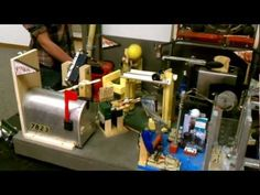 Check out this record-breaking Rube Goldberg device that peels fruit, makes hamburgers, and toasts bread.