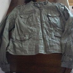 GUESS Spring Grey faux leather scuba jacket Super cute. Only worn 2 or 3 times. Distressed to give it a worn/wrinkly look but very unique. All zippers/snaps/buttons function exactly as they should. Armpit to armpit is 19 1/2 and top of sleeve to bottom of cuff is 25 1/2. This actually fir like a true large to me. Hadn't run as small as my other guess jackets and is really comfy. Great for fall/spring transitions. Originally purchased from Wilson's leather Guess Jackets & Coats