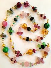 Are you in the mood for #SPRING? So are we! Check out these Spring-y #jewelry #designs #gemstone #tourmaline #pink #green #gold #necklace #bead