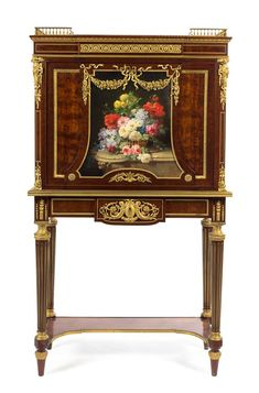 A Louis XVI Revival Gilt Bronze Mounted Mahogany Secretaire a Abattant. second half of 19th century. Height