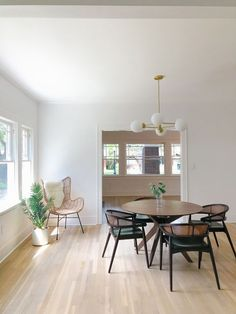 mid century mod dining room | 102-year-old fixer upper house renovation | mid century modern Scandinavian home design | house flip reno