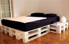 Now come to the idea for the bedroom, the repurposed wood pallet bed has the side tables attached to the bed and the color used for painting the pallets is white which is giving it a sober look. The base of the bed is stylish and it's usually not seen in the market.