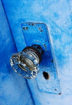 obsessed with blue doors and glass knobs