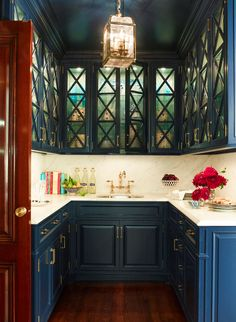dark blue cabinets in pantry, Color: Ashley Whittaker | Christina Wilcomes Interiors and Decoration