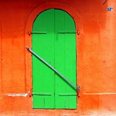 Green door and orange wall  Pointe a Pitre,Guadalupe, French West Indies (Lesser Antilles).