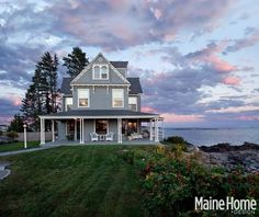A Victorian Beach House in Maine - I may be into tiny houses and little cottages, but I'm also in love with this beach house with the amazing porch!