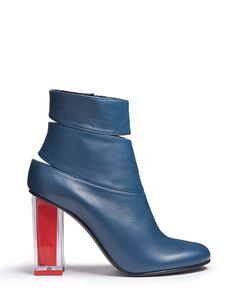 A peel of leather that shelters and showcases your foot, GLINDA is a vixen heel. With a one of a kind prismatic heel, her bootie upper, incised and soft, suppor