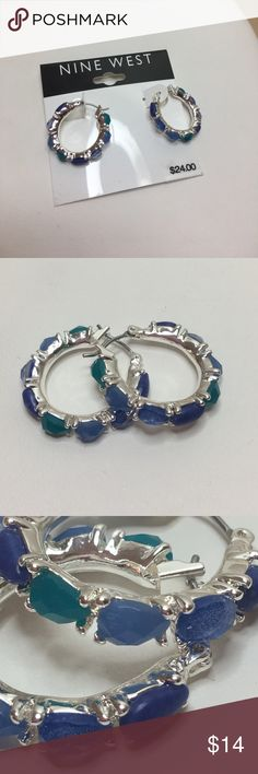 """NWT Nine West Silver and Blue Hoop Earrings A pair of silver hoop earrings by Nine West, about 3/4"""" in diameter. Accented with tiny faceted resin stones around the outside of the earrings in mixed blue colors. New with the original tag! Cool and classy earrings for the Spring and Summer months. Check out the Nine West bracelet in my closet that complements these earrings! Nine West Jewelry Earrings"""