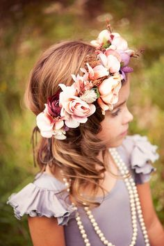 This gorgeous and voluminous flower crown is made with the highest quality silk flowers in shades of plum/purple, rose/pink, and peach. It also has a couple of mini pinecones and greenery. This looks