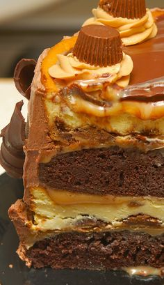 Might have to try to make for Jason....QUADRUPLE LAYER PEANUT BUTTER CHOCOLATE CARAMEL CHEESECAKE!!!!