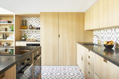 A compact, luxe kitchen in a Paris pied-a-terre by Commune of LA. Moroccan cement tiles are Commune design for Exquisite Surfaces| Remodelista