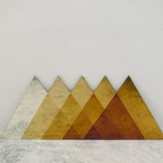 Gorgeous geometric mirrors oxidized with sulfur into a nice golden ombre.