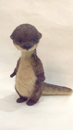 Diva By Teddyana - Diva the otter is made of plush. She has black glass eyes and polymer clay nose.
