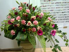 "Mass Arrangement Bella Pink... Carnations... Gerbera's and Red Roses ""Mr. President"""