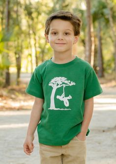 Boy on a Tire Swing Short Sleeved Nostalgic Graphic Tee, designed and printed in the US