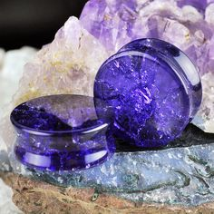 """Amethyst colored glass with """"cracked"""" interior. Although the plugs looked cracked, all surfaces are smooth. Quantity: Sold as 1 pair (2 pieces) Style: Round plug Flare: Double flare (saddle) Width: 13"""