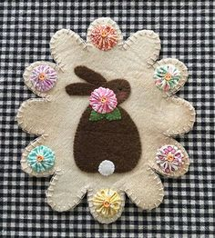 This is a cute little bunny wool penny rug. It can be used for Easter, spring, or Primitive decor in any room. Size is 8 long x 7 wide Colors are beige, brown, green, white, turquoise, pink, yellow, orange Beads, buttons and fabric yo-yos used for embellishment. Price is