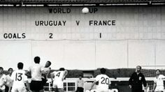 Uruguay and France do battle in the 1966 World Cup.
