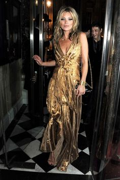 2012: At the launch of Kate: The Kate Moss Book wearing a gilded Marc Jacobs gown.