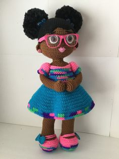 Crochet Doll with two afro puffs; 20-22 inches tall on average. Can be created in any of the 17skin tones. Clothing can also be made in any color. Hair styled in two Afro puff with hair ties it bows to match clothing. You have the option of stud earrings or little gold or silver hoops.